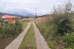 road from land to main road