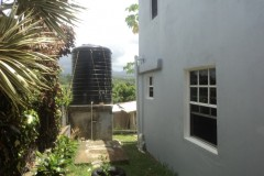 side of home with water tank